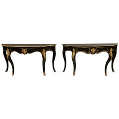 Pair of French 19th Century Ebonized Console Tables with Brass Mounts