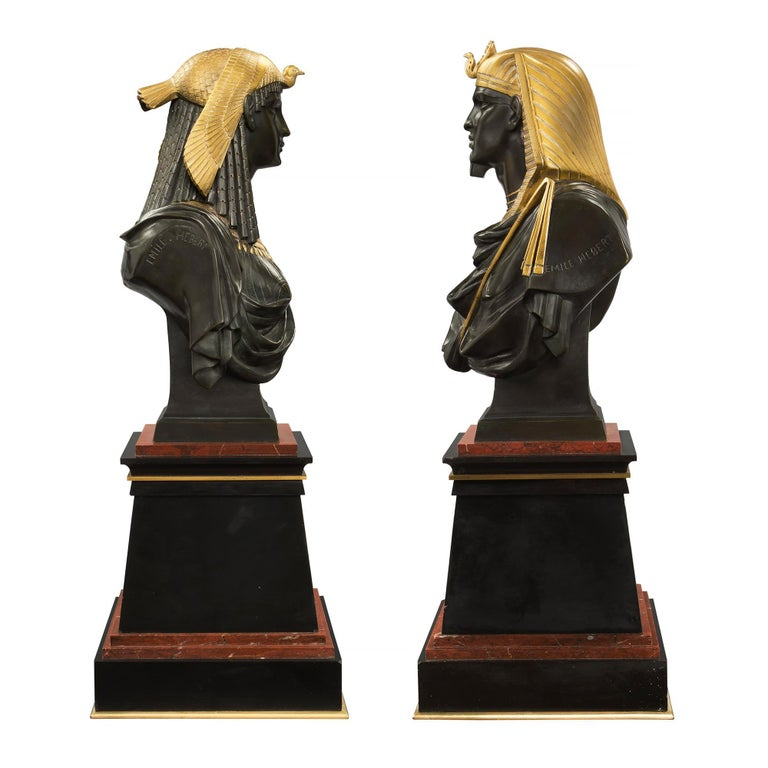 A very handsome pair of French 19th century Egyptian Revival style busts of Ramses the II and his wife Isis, signed by Pierre-Eugène-Émile Hébert. Each is raised on a black Belgian marble base with ormolu trim and etched eagle design on the front,