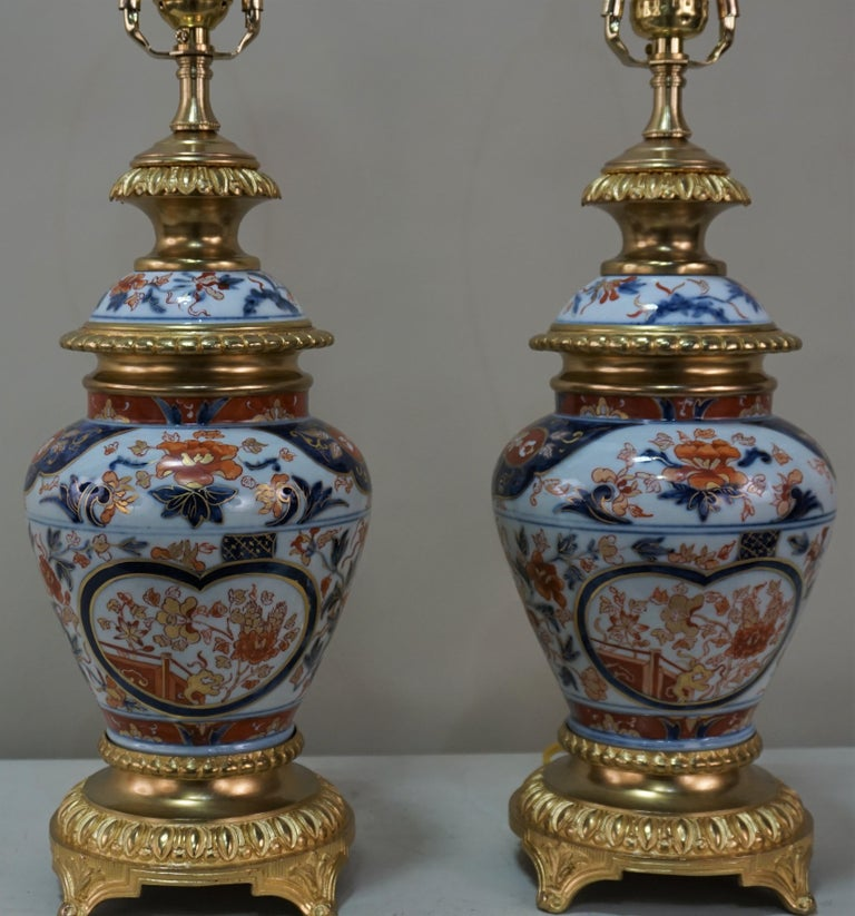 Pair of Japanese porcelain with bronze doré mounting table lamps. Professionally electrified and fitted with silk lampshades.