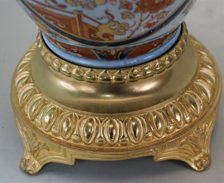 Bronze Pair of French 19th Century Electrified Porcelain Oil Lamp For Sale