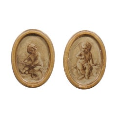 Pair of French 19th Century Framed Oval Grisaille Paintings Depicting Two Putti