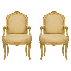 Pair of French 19th Century Louis XV St. Giltwood Armchairs