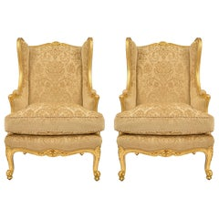Pair of French 19th Century Louis XV St. Giltwood Bergères À Oreilles