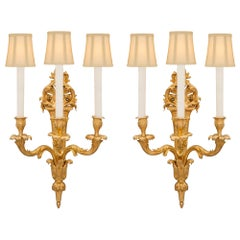Pair of French 19th Century Louis XV St. Ormolu Sconces