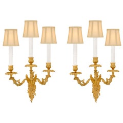 Pair of French 19th Century Louis XV Style Ormolu Three-Arm Sconces