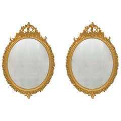 pair of French 19th century Louis XV st. oval mirrors