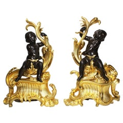 Pair of French 19th Century Louis XV Style Gilt Bronze Chenet with Children