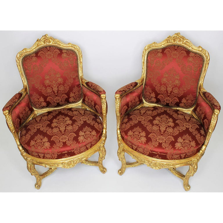 A very Fine pair of french 19th century Louis XV style giltwood carved marquises bergère armchairs. The ornately carved gilded frames with floral and acanthus motifs with rounded edges, padded upholstered sides and armrests, on four cabriolet legs