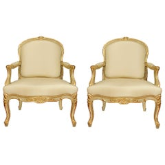 Pair of French 19th Century Louis XV Style Patinated and Gilt Armchairs