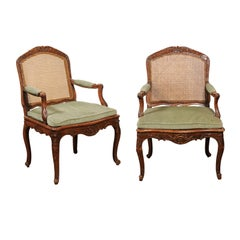 Pair of French 19th Century Louis XV Style Walnut and Cane Upholstered Armchairs