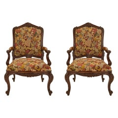 Pair of French 19th Century Louis XV Walnut and Tapestry À Chasis Armchairs