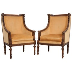 Pair of French 19th Century Louis XVI Carved Walnut Bergères