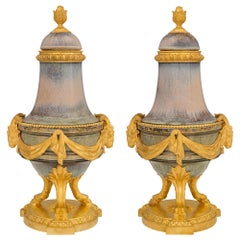 Pair of French 19th Century Louis XVI Glazed Porcelain and Ormolu Lidded Urns