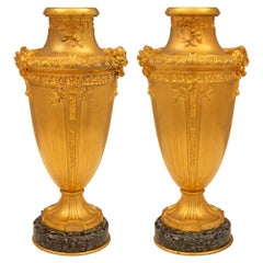 Pair of French 19th Century Louis XVI St. Ormolu and Verde Antico Marble Vases
