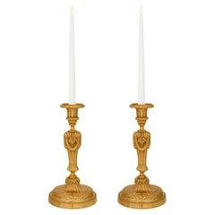 Pair of French 19th Century Louis XVI St. Ormolu Candlesticks