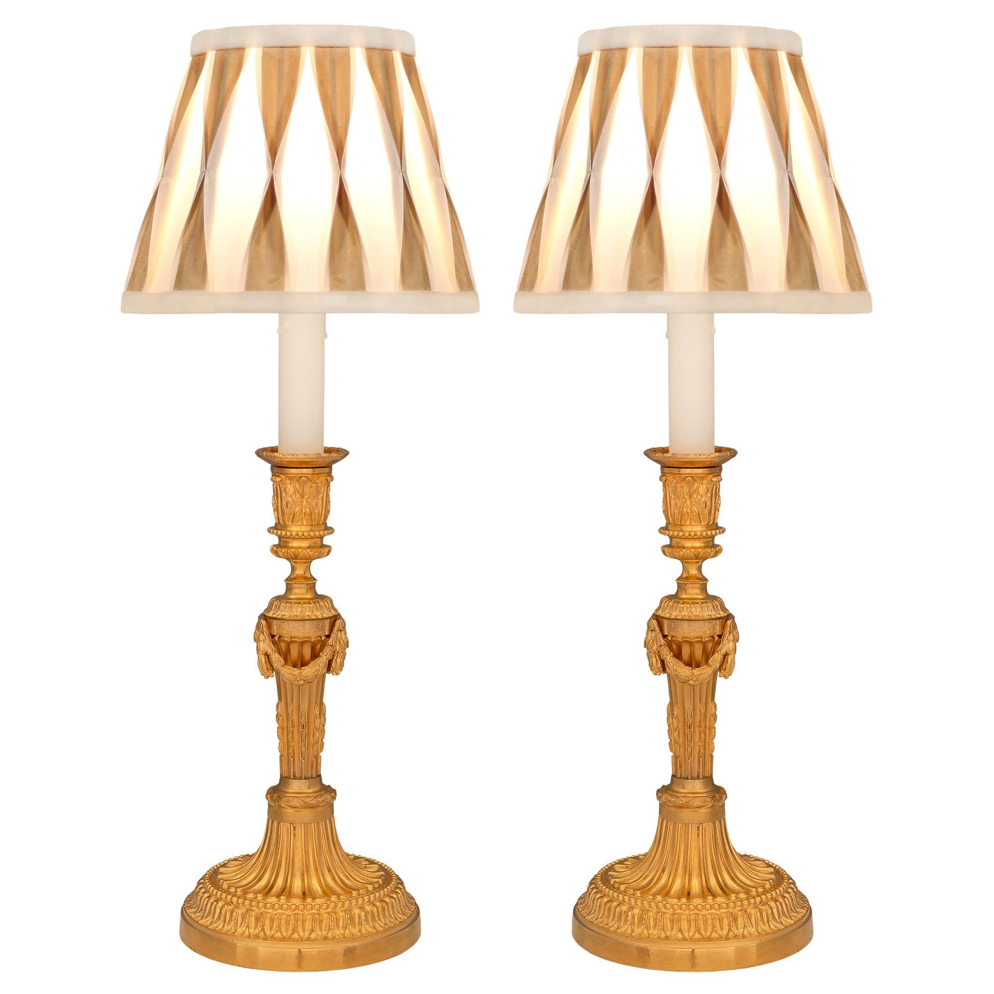 Pair of French 19th Century Louis XVI St. Ormolu Lamps