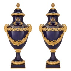 Pair of French 19th Century Louis XVI St. Porcelain and Ormolu Urns