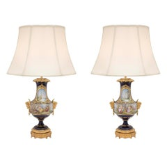 Pair of French 19th Century Louis XVI St. Sèvres Porcelain and Ormolu Lamps
