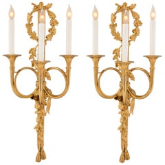 Pair of French 19th Century Louis XVI Style Ormolu Three-Arm Sconces