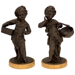 Pair of French 19th Century Louis XVI Style Patinated Bronze and Ormolu Statues