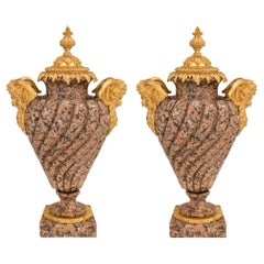 Pair of French 19th Century Louis XVI Style Pink Granite and Ormolu Urns