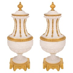 Pair of French 19th Century Louis XVI Style Porcelain and Ormolu Lidded Urns
