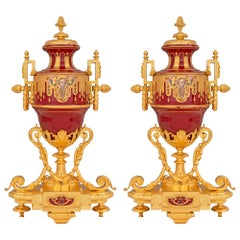 Pair of French 19th Century Louis XVI Style Porcelain and Ormolu Urns