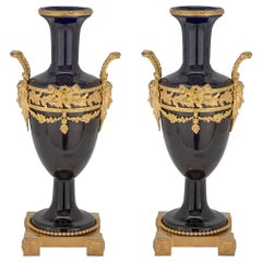Pair of French 19th Century Louis XVI Style Porcelain and Ormolu Vases