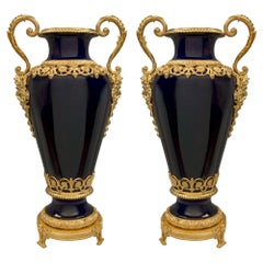 Pair of French 19th Century Louis XVI Style Sèvres Porcelain and Ormolu Vases