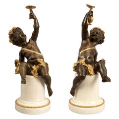 Pair of French 19th Century Louis XVI Style Statues of Joyful Cherubs