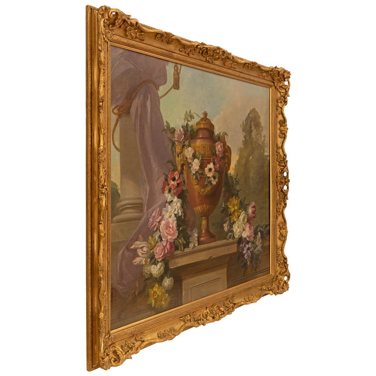 A beautiful and extremely decorative pair of French late 19th century Neo-Classical st. still life oil on canvas paintings. Each painting is set within its original frame decorated with richly carved scrolled foliate designs in a striking satin and