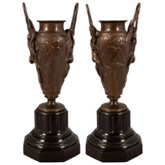 Pair of French 19th Century Renaissance Bronze and Black Belgian Marble Urns