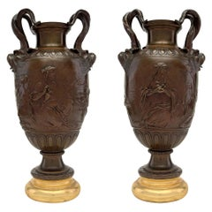 Pair of French 19th Century Renaissance Style Patinated Bronze and Giltwood Urns