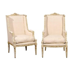 Pair of French 19th Century Wingback Bergères Chairs with Richly Carved Décor