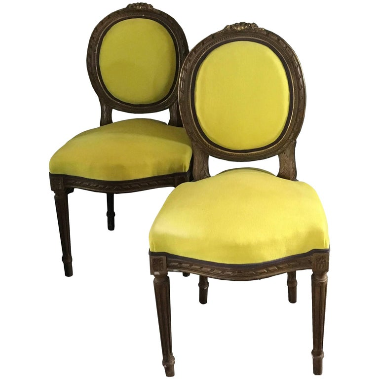 Pair of Louis XVI–style chairs upholstered in yellow linen, 1850, offered by DD Dimore
