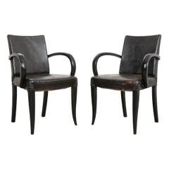 Pair of French 20th Century Ebonized Art Deco Armchairs