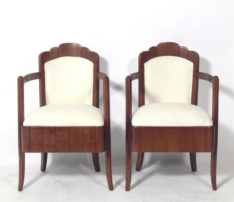 Pair of Art Deco armchairs, designed by Pierre Patout, for the Ile de France ocean liner, French, circa 1930s. They have been completely restored. Refinished in their original color and reupholstered in an ivory bouclé fabric.