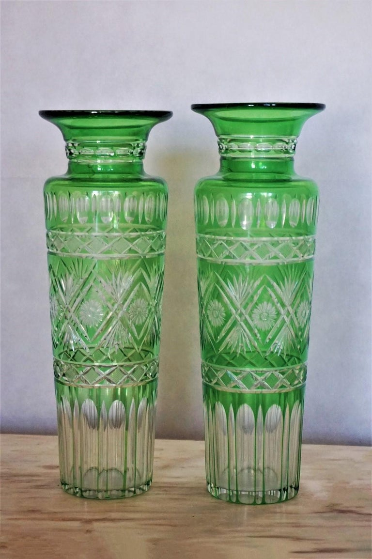 Pair of hand blown crystal vases green cut to clear with elegant and clean lines in Art Deco design, France, circa 1920-1930.