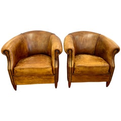 Pair of French Art Deco Distressed Leather & Nailhead Cigar Club Chairs