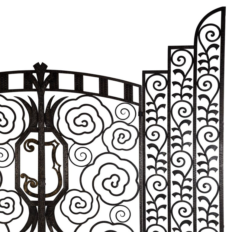 An exceptional and highly decorative pair of French wrought iron internal gates. Dating from the late 1920s-early 1930s, these rare gates are of the highest quality and in complete original condition.