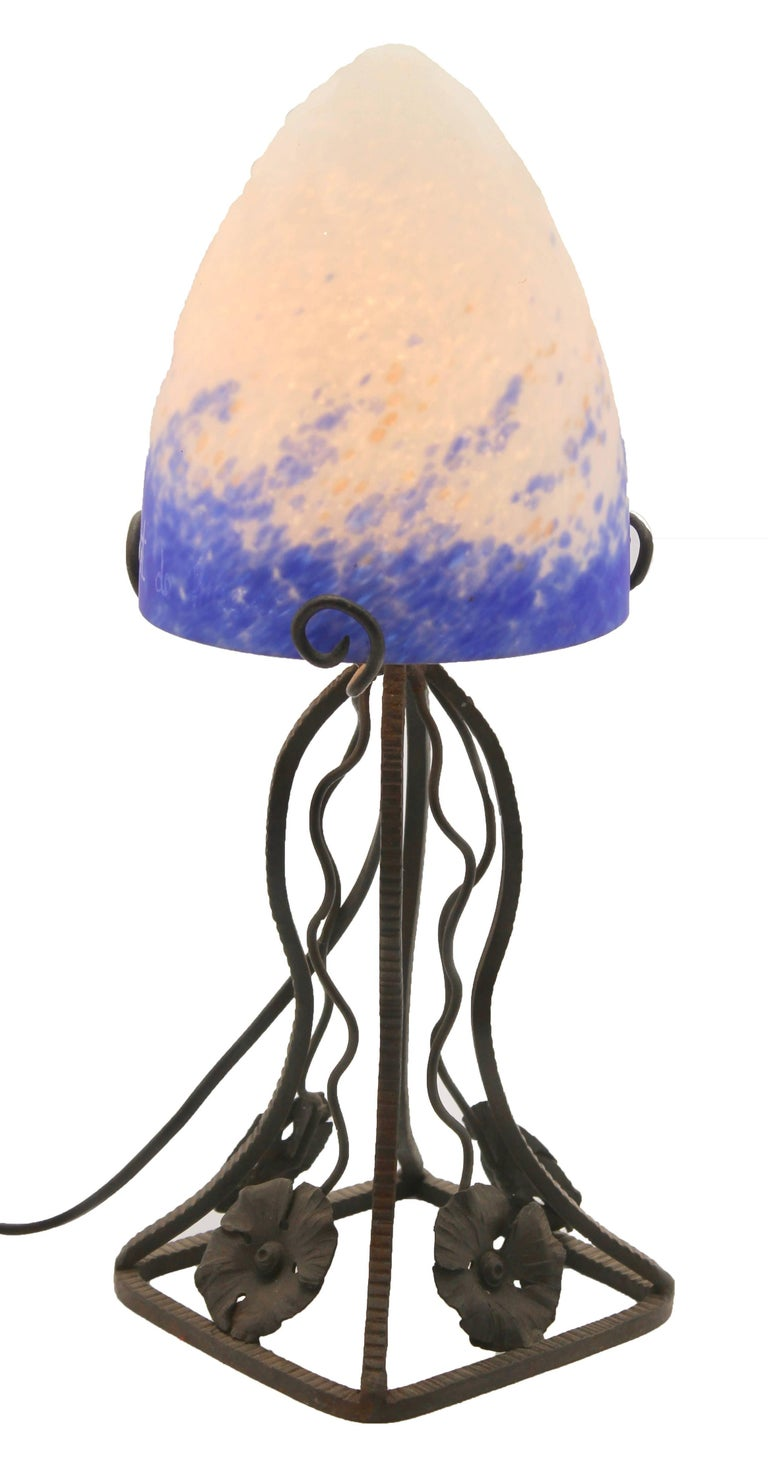 Art Nouveau Pair of French Art Deco Lamps in Wrought Iron with Colored Glass Shades Signed For Sale