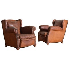 Pair of French Art Deco Leather Upholstered Club Chairs, 20th Century