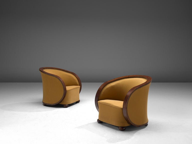 Pair of lounge chairs, wood and fabric, France, 1940s.
