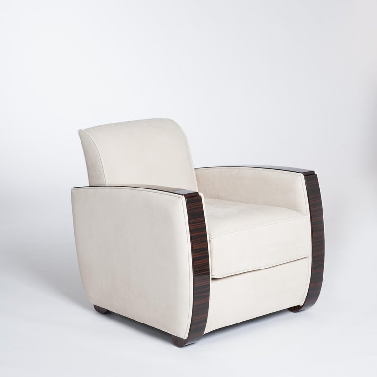 Pair of very elegant and extraordinary shaped Art Deco armchairs. Fine Macassar veneer (width 7.5cm) in combination with sandy colored nubuckleather fabric by STOLZ/Belgium. The velvet nubuckleather shows a sensual softness with a warm and charming