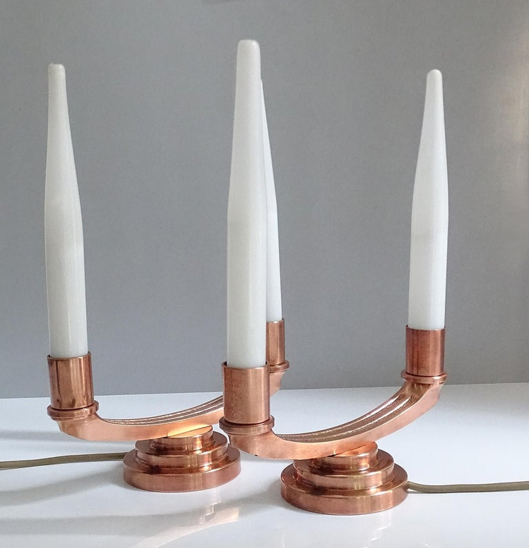Pair of extremely rare French Art Deco modernist girandoles made of copper plated brass and bronze, with partial patina (centre section), with each two lights covered with a flute style opaline glass shade, tall, elegant proportions. Girandoles were