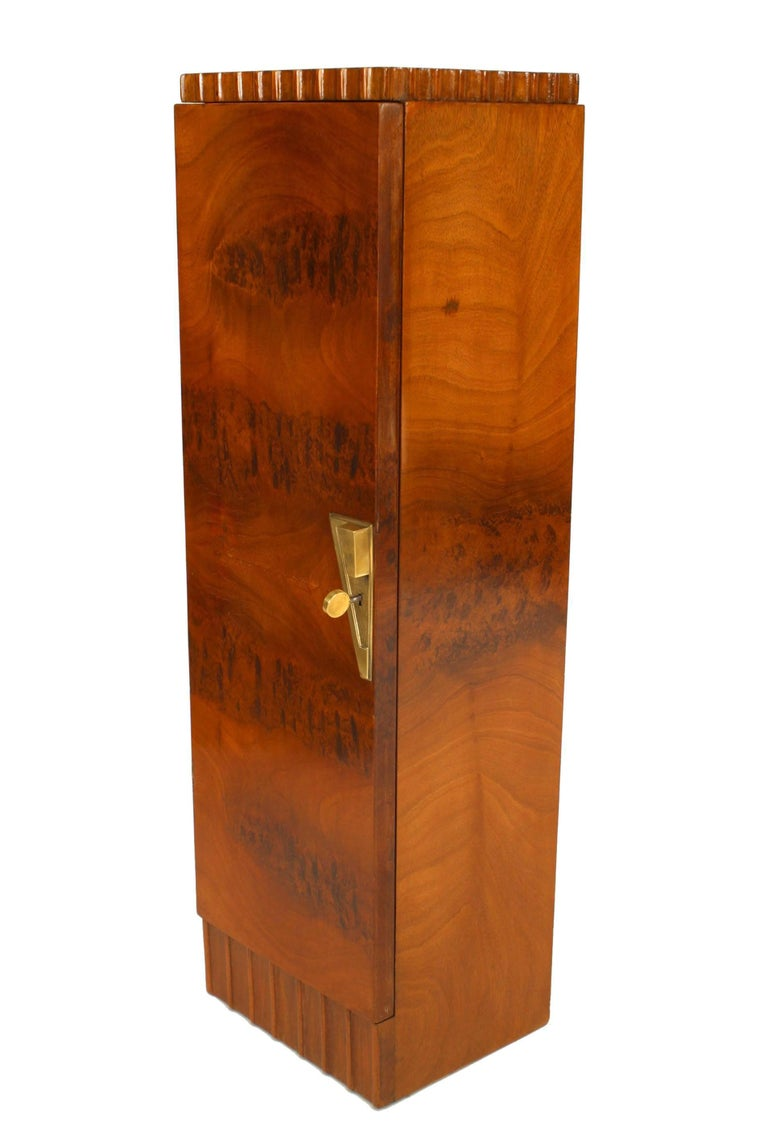 Pair of French Art Deco mahogany veneer pedestals/cabinets with a fluted top & bottom edge and a front door with a bronze geometric form key plate, finished on back. (att: Roger Bal).