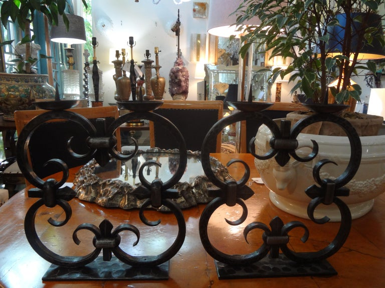Beautiful rare pair of French Art Deco hand forged wrought iron candelabra, candlesticks or candleholders by Michel Zadounaïsky. These candleholders are stamped with the maker's mark.