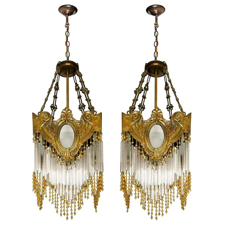 Beautiful pair of antique French Art Nouveau Art Deco gilded solid cast bronze lanterns and amber beaded glass straw fringe, 2 tiers. Measures: Depth 8.7 in /22 cm Width 8.7 in /22 cm Diagonal 12 in/ 30 cm Height 36.6 in (11.8b in/chain) / 93