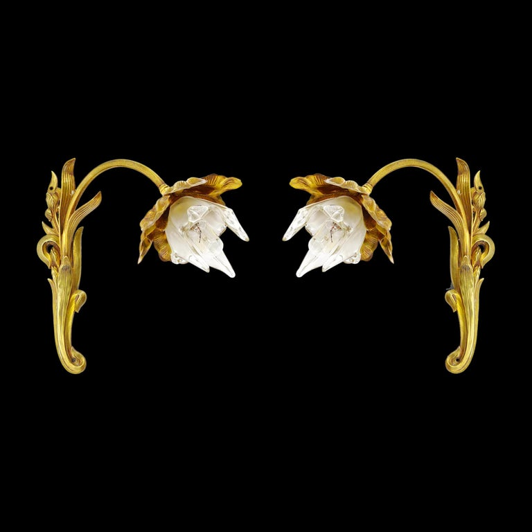 French Art Nouveau pair of wall sconces, France, circa 1900. Bonze and glass. Each wall light represents an iris. Lampshades are made of glass worked with pliers. The glass is partially frosted. Measures: Height 11.2