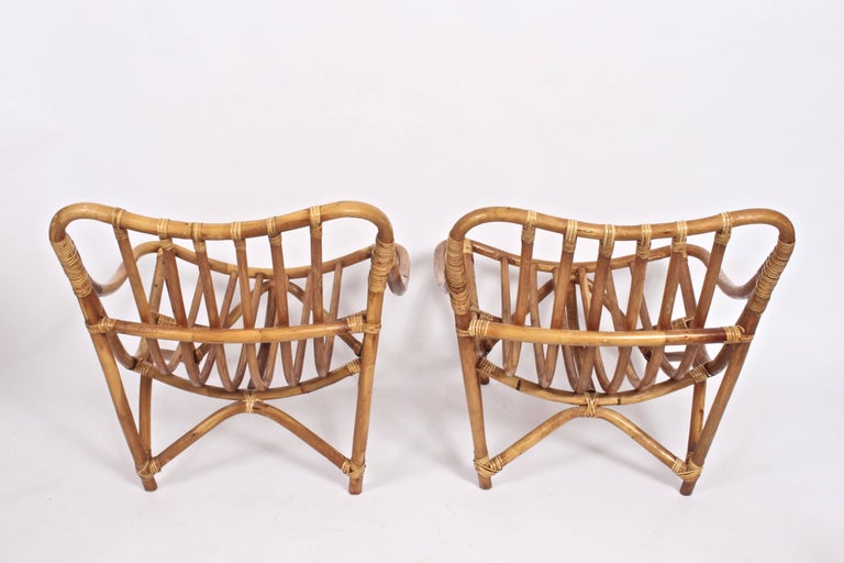Substantial oversized European Organic Modern Rattan wrapped Bamboo Armchairs. Comfortable. Smooth curved lines. Arm height 16 H. Shown without cushions. As seen in the film Beautiful Boy. Indoor outdoor use. For use year round in dry outdoor